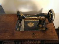 I'm offering my antique singer stitching machine for