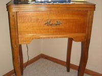 Beautiful solid wood antique sewing machine