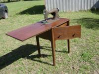 Sewing Machine Store Owners, & Collectors, An antique