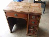 Nice antique sewing machine cabinet that needs to be