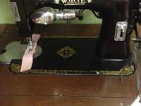 Several antique singer and white brand machines treadle