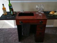 We have a restored antique sewing table that has been