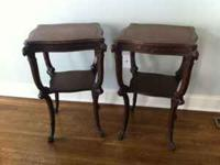 We have for sale 2 antique side tables with carved legs