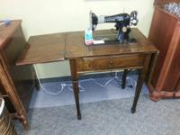 1926 Singer Sewing machine in walnut cabinet.  It still