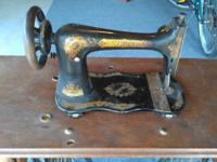 a black and gold singer sewing machine with stand and