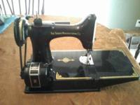 I HAVE AN ANTIQUE SINGER SEWING MACHINE FROM THE 1940'S