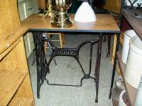 We have an antique Singer stitching device stand that