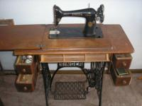 This gorgeous antique Singer stitching device is a
