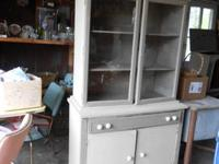 I HAVE AN EARLY 1900'S SMALL CHINA HUTCH/CABINET,