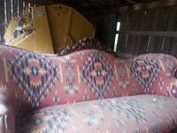 Antique sofa covered with southwestern print. Needs to