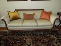 This is a mahogany Duncan Phyfe style couch from the