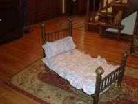 This is a beautiful antique solid brass doll bed, or