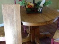 Solid seasoned light oak round table. Moving and have
