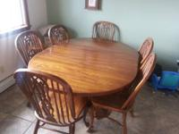 Antique Solid oak table complete with 6 chairs and 2