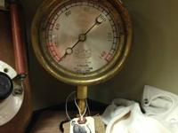 This is an antique steam stress gauge made by the Star