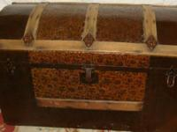 This embossed tin and wood steamers trunk is in great