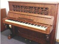 This Antique Steinway & Sons Vertical piano in cherry