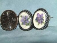 A very nice petit point pin with voilets. It is 1 1/2""