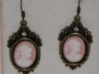 Lovely white cameos with pink background are mounted on