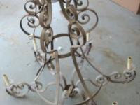 Wonderful antique style iron 6 light chandelier. Has
