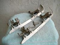 This pair of vintage Austrian clamp on ice skates is of