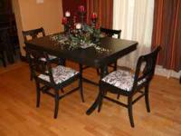Cool antique table redone in Black with new fabric With