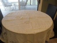 6' round table cloth. Linen with detailed lace in the