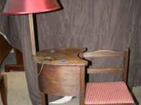 Antique telephone table. Has attached lamp with 2 holes