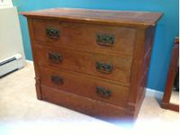 This is an antique three drawer dresser in original