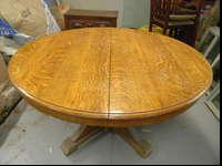 Lovely tiger oak antique table with wheels. Dimensions