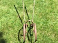 "Antique tiller. Wheel diameter 16"".  Handle 50"". Handle"