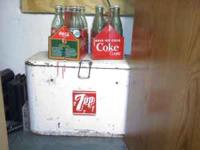 I have a nice unrestored tin 7 up cooler in good shape