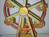 This antique toy ferris wheel is made of metal and was