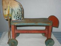 This antique wood riding horse, from the 1930's -