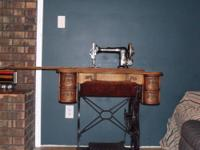 We have 2 antique treadle style sewing machines in