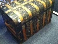 Large antique steamer trunk can be seen in booth 22 at