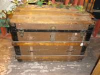 A huge antique trunk with original drawer inside. It is