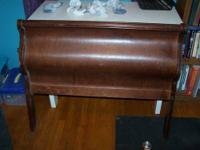 This cherry sleigh bed is an antique and could probably