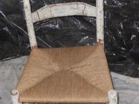 Antique unfinished worn-out elegant chair. The size of