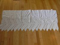 This linen and hand crocheted lace piano scarf is well