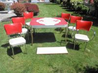 For sale here is a vintage table and 6 chair embeddeded