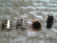 Two sets of men's cuff links. The first pair is from
