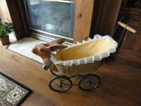 This Rare Antique Vintage Stroller has a bunny head on
