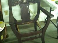 For sale below is a ANTIQUE CHAIR WITH A CREATED HEAD