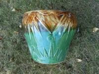 This is an antique/vintage pottery planter or