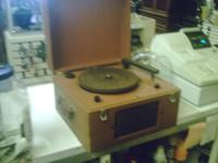 I HAVE A VERY OLD ANTIQUE VINTAGE RECORD PLAYER FOR