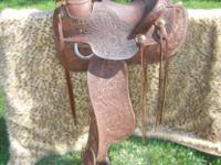 This saddle was made and hand tooled by ALLEE (see pic)