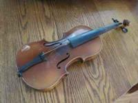 This antique violin needs some restoration, but the