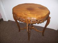 This is a beautifully ornate wall table with intricate