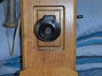 Oak wall phone in working order.  Bells operate and